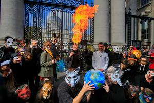Call for action: Extinction Rebellion climate activists during a protest outside government buildings in Dublin. Photo: Collins Dublin, Gareth Chaney