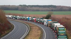 Lorries queue on the A256 outside Dover, part of the landbridge to Ireland,  during trials for post-Brexit disruption at Britain's  channel ports. Photo: Gareth Fuller/PA