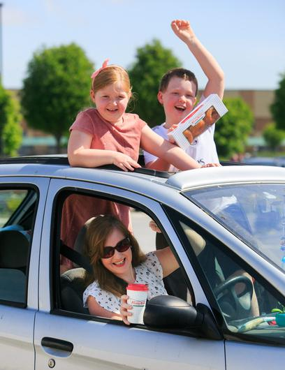 Treats: Nurse Marcella Hunt with her children Adam and Gemma at the reopening of Krispy Kreme Drive-thru, Blanchardstown last May. Photo:Gareth Chaney/Collins