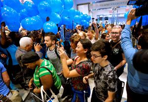Shoppers walk past balloons and cameras at they enter a Primark store in Boston