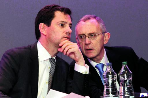 Pictured at the Smurfit Kappa Group AGM in May were Former Anglo Irish Bank director Gary McGann (right), current Smurfit Kappa Group Chief Executive Officer, with Tony Smurfit, Chief Operations Officer