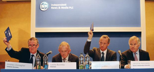At the INM extraordinary general meeting yesterday in the Conrad Hotel, Dublin, were, from left, company secretary Andrew Donagher, chairman Leslie Buckley, chief executive Vincent Crowley, and senior independent director Jerome Kennedy