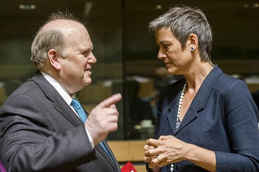 Finance Minister Michael Noonan talks with Denmark's Economy Minister Margrethe Vestager during the European finance ministers' meeting in Luxembourg, yesterday.