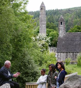 VISITORS: Michelle, Malia (right) and Sasha Obama with Glendalough guide George McClafferty.