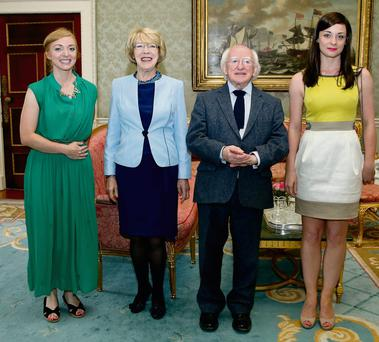 President Michael D Higgins and his wife Sabina with Alys Harte (left) and Emma Cawley, from Donegal, at the Aras garden party