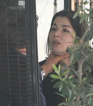 High-profile Split: Charles Saatchi grabbing the throat of distressed wife Nigella Lawson in London.