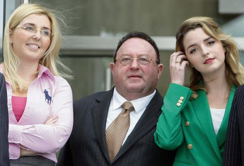 James Kennedy leaves court yesterday with his daughters after corruption charges were dropped