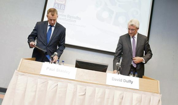 AIB chief financial officer Paul Stanley and chief executive David Duffy at the bank's headquarters yesterday. AIB said first-half losses narrowed to €758m
