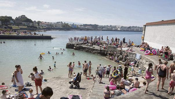 Members of the public enjoying the good weather at Sandycove,Dublin