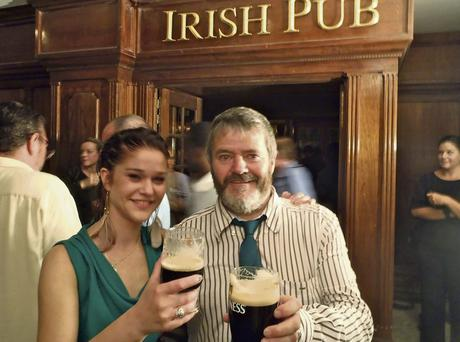 RAISING A GLASS: Enda O Coineen with a patron at his Irish pub in Haiti. He has helped organise a Gathering of Irish pub owners and managers from around the world