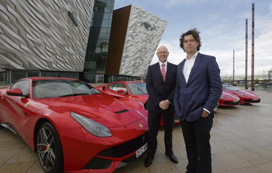 Sunday Independent Business Editor Nick Webb, right, and Charles Hurst franchise director Richard Stinson with the Ferrari 458