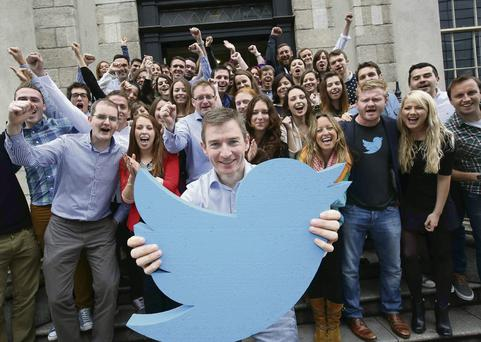 Twitter's MD in Ireland Stephen McIntyre (centre) with Dublin Twitter staff at Dublin HQ