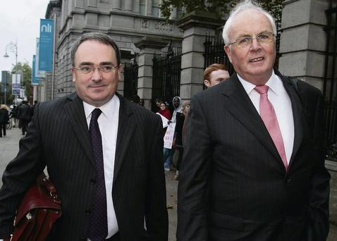 NAMA chief executive Brendan McDonagh with chairman Frank Daly arriving at Leinster House yesterday