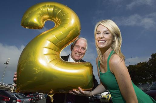 TWO YEARS HERE: CEO Jim McCarthy and model Pippa O'Connor