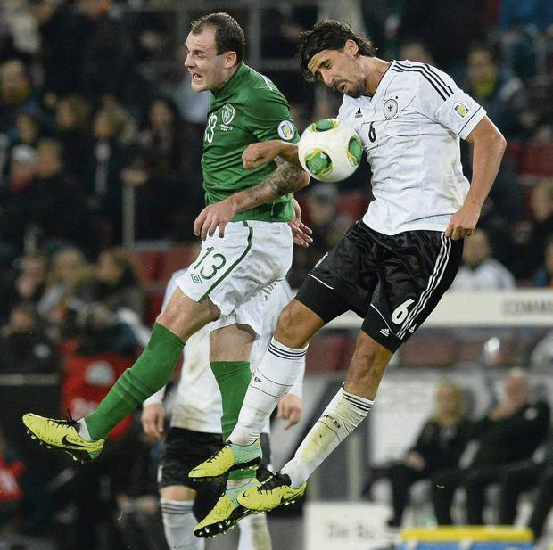At loggerheads on and off the pitch: neither Anthony Stokes nor Sami Khedira could keep their eyes open on Friday.