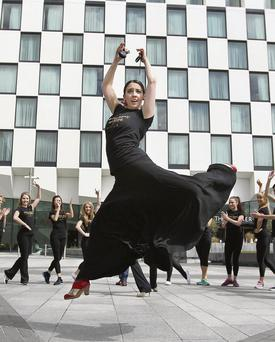 HAS THE FIRE GONE OUT? Dancers kick up their heels outside the Bord Gais-sponsored Grand Canal Theatre.