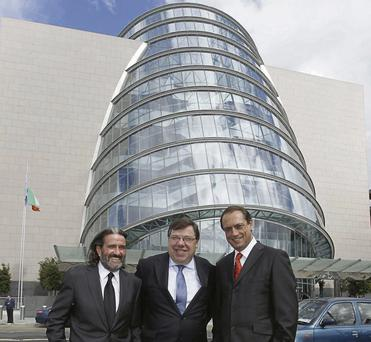 Former Taoiseach Brian Cowen (centre) with Johnny Ronan (left) and Richard Barrett at the opening of the convention centre in 2010
