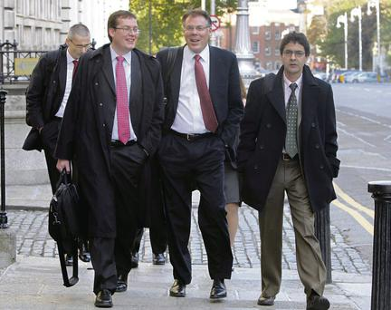 The final visit by troika officials took place this week. IMF official Peter Breuer (left), Craig Beaumont (centre), IMF Mission Chief for Ireland, and other members of the delegation are pictured leaving the Department of Finance