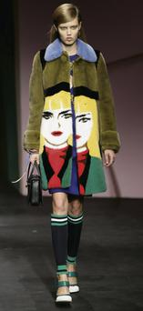 A model presents a creation from Prada Spring/Summer 2014 collection during Milan Fashion Week. Prada chose the ISE for the listing debt issuance