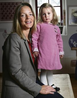 TRENDY: Cathy Slattery with her daughter Ellis in a Darcy Brown dress. Photo: Tony Gavin
