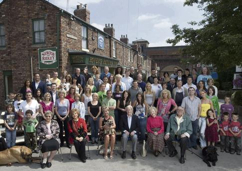 Exciting twist: The cast of Coronation Street celebrate 50 years of the show. It's still worth its weight in advertising gold, bringing in millions every year
