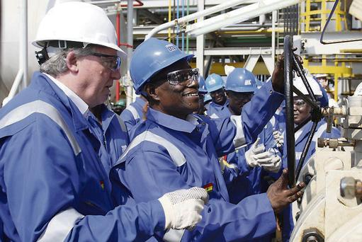Tullow staff celebrating the pumping of oil from an African field. The latest find – in Kenya – is the company's fifth oil find in that country.