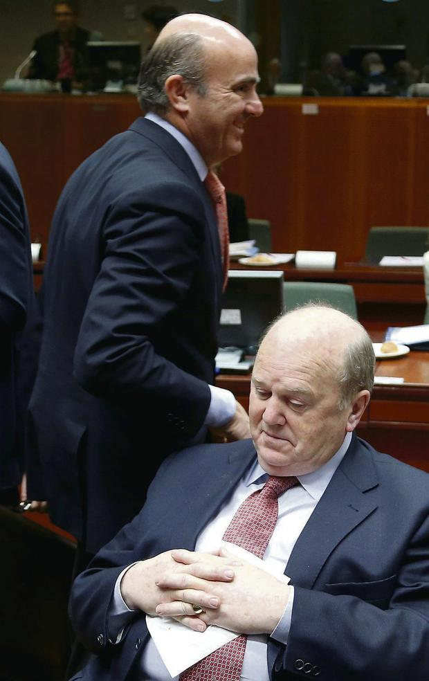Michael Noonan, pictured recently at an EU Finance Ministers' meeting, says a date currently can't be pinned down