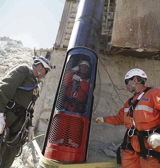 Workers prepare to release a colleague from a capsule after performing a dry run test for the eventual rescue of the 33 miners trapped at the San Jose mine, near Copiapo, Chile.