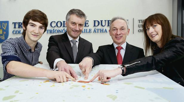 Co-founders of Foodcloud Alex Sloan and Emma Mooney with Trinity Provost Dr Patrick Prendergast (second from left) and Minister for Jobs, Enterprise and Innovation Richard Bruton in the Trinity Biomedical Sciences Institute in Dublin