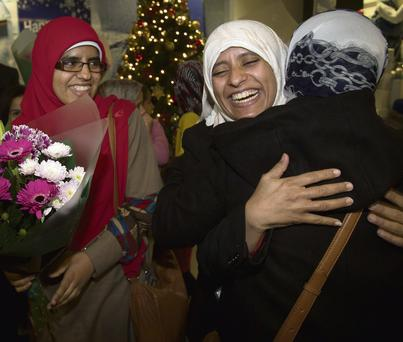 BACK HOME: Sisters Fatima and and Somaya Halawa are greeted by friends and relatives as they arrive in Dublin Airport yesterday after being released from prison in Egypt. Photo: Tony Gavin