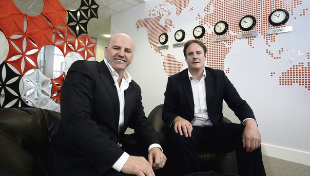 TIME IS MONEY: Sean Gallagher, left, with Export Technologies CEO, Dan Loughlin in its offices at the Northern Ireland Science Park, in Belfast