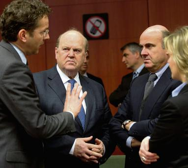 Finance Minister Michael Noonan (second left) during a meeting of his eurozone counterparts in Brussels. Picture: Virginia Mayo