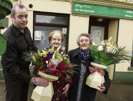 Martin Canning, postmaster at Ballyvary Post Office in Co Mayo, with Mrs Katie Stenson and Mrs Sarah Deacy. Post offices have a large role in rural communities.