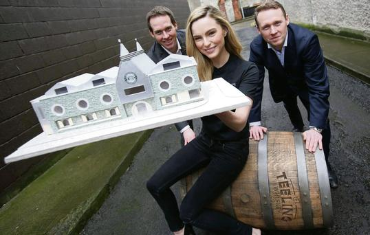 Model Sarah Morrissey with Stephen Teeling, sales and marketing director, and Jack Teeling, managing director of the Teeling Whiskey Company. CONOR McCABE PHOTOGRAPHY