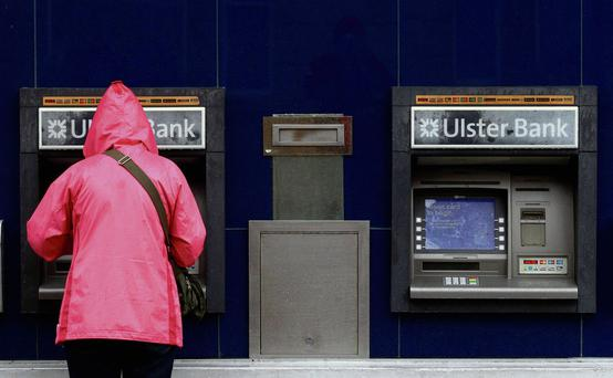 A customer uses a cash machine at a branch of the Ulster Bank in Coleraine. Photo: Cathal McNaughton/Reuters