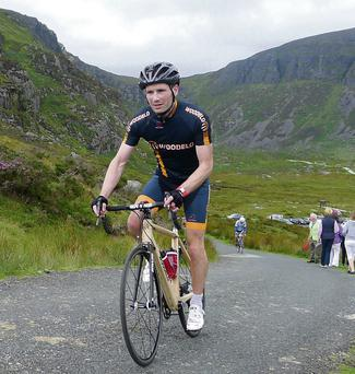 Liam Murray taking to the hills on the Woodelo bike