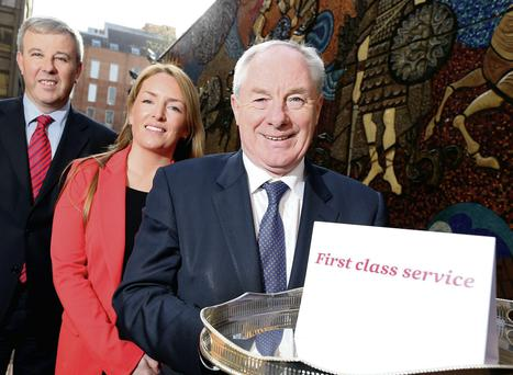 Paul Tuite and Jennifer Gillen of PwC Ireland with Minister of State Michael Ring. Photo: Maxwell