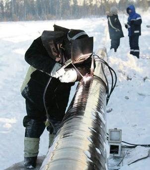 An engineer works on the Siberia-focused, oil-production company PetroNeft pipeline.
