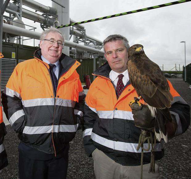 Pictured at the launch of the Bord na Mona Landfill Gas Utilisation Project is Pat Rabbitte TD, Minister for Communication, Energy and Natural Resources and Garrett Leech, Environmental Manager, Resource Recovery, Bord na Mona, with a Hawk utilised to maintain the landfill