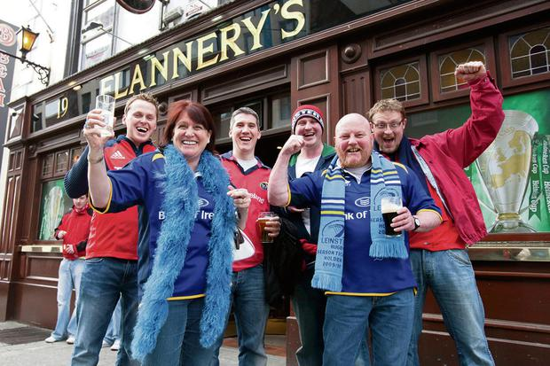 Cheers: rugby fans enjoy a pint
