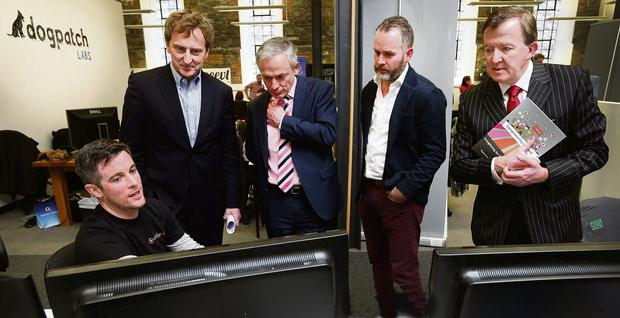 From left, Viddyad chief technology officer Eamonn Kennedy, investor Sean O'Sullivan, Minister for Jobs, Enterprise and Innovation Richard Bruton, Noel Ruane of Polaris Venture Partners, and Minister of State for Small Business John Perry, at Dogpatch Labs in Dublin
