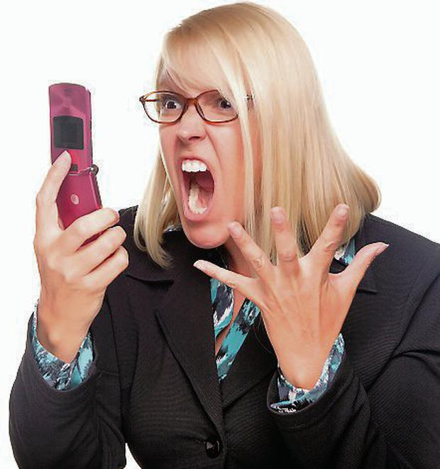 Angry Woman Yells At Cell Phone Isolated on a White Background.