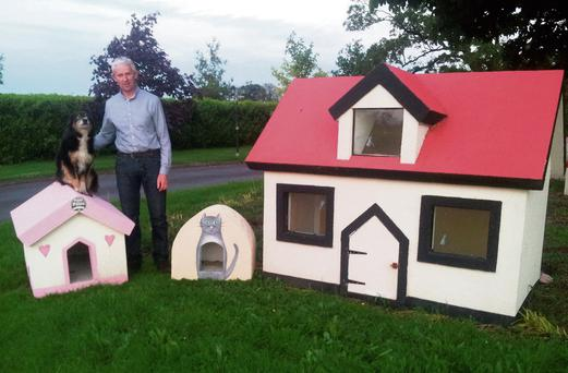 Pat Daly and his dog Jack with some of the showhouses