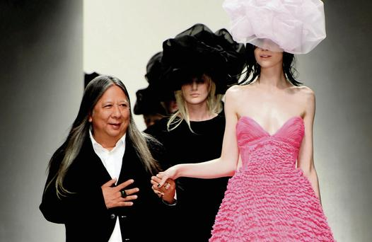 Designer John Rocha walks with his models on the catwalk. Photo: Ian Gavan/Getty
