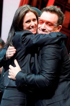 "Julie Taymor and Bono appear onstage at the curtain call for the opening night performance of the Broadway musical ""Spider-Man: Turn Off the Dark"" in New York"