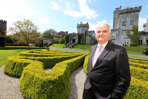 General manager Mark Nolan outside Dromoland Castle, which has hosted guests including US Presidents George Bush and Bill Clinton (pictured at the hotel) Nelson Mandela and, more recently, Bono