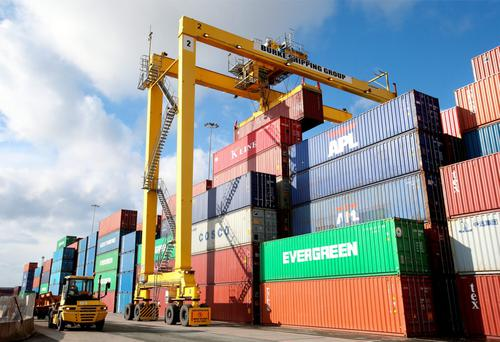 A crane stacks containers at Dublin Port