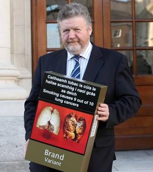 Minister James Reilly spearheaded the drive to force tobacco companies to remove all branding from cigarette packs
