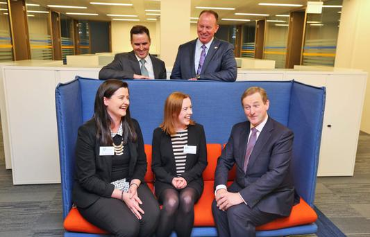 Taoiseach Enda Kenny with Timothy Walbert (back right), Martin Shanahan, CEO of IDA Ireland, and staff members Megan McGroary and Anne Marie Gittens at the official opening of the new global headquarters of Horizon Pharma in Dublin yesterday