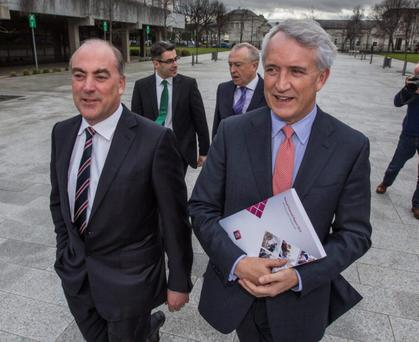 AIB SUCCESSION: Allied Irish CFO Mark Bourke with outgoing CEO David Duffy walk ahead of chair Richard Pym and COO Stephen White. Photo: Mark Condren